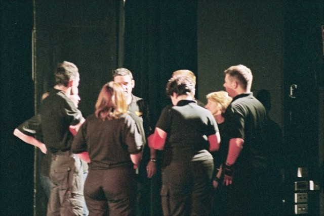 """Simpol Staging in action...well, having a team talk, """"hands up who wants doughnuts""""."""